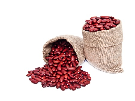 Red beans in bag on white background  photo