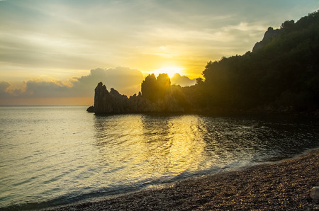Mediterranean Sea, Cirali Beach. Dawn. The sun rises from the rocks.