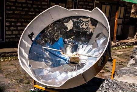 concave: Solar cooker in the Himalaya mountains in the Khumbu region on the way to Everest Base Camp. Nepal Stock Photo