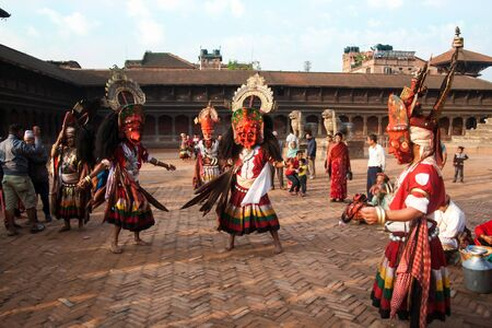 incubus: BHAKTAPUR, NEPAL - APRIL 19, 2013:Several unidentified Lama perform a ritual dance called Bhairav Dance in Bisket Jatra is  which is held during the celebration of Nepali New Year on the square in Bhaktapur.