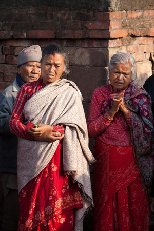 incubus: BHAKTAPUR, NEPAL - APRIL 19, 2013:Residents of Bhaktapur watch a ritual dance called Bhairav Dance in Bisket Jatra is  which is held during the celebration of Nepali New Year on the square in Bhaktapur. Editorial
