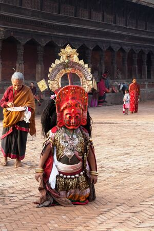 incubus: BHAKTAPUR, NEPAL -  APRIL 19, 2013: Unidentified Lama ready to perform a ritual dance called Bhairav Dance in . Bisket Jatra is a Hindu festival that provoitsya in Bhaktapur during the celebration of Nepali New Year. Editorial