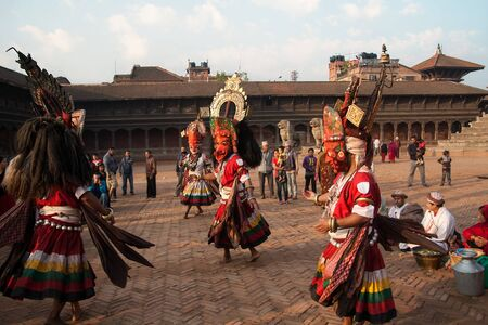 incubus: BHAKTAPUR, NEPAL -  APRIL 19, 2013:Several  unidentified Lama  perform a ritual dance called Bhairav Dance in . Bisket Jatra is a Hindu festival that provoitsya in Bhaktapur during the celebration of Nepali New Year.