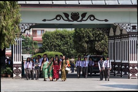 nepali: KATMANDU, NEPAL -  APRIL 18 2013: Nepali  schoolchild and young teachers leave school.