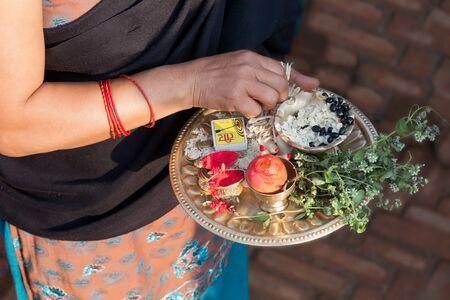 incubus: Plate with a donation to the gods in the hands of the Nepalese woman Stock Photo