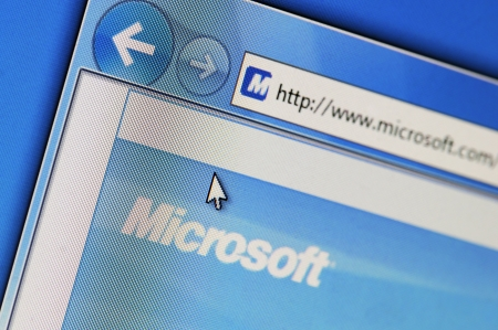 Essen, Germany - February 28, 2011: Part of Microsoft site in Internet Explorer browser on LCD screen. Microsoft was founded in 1975 by Bill Gates and Paul Allen. The company is known for its Windows operating system and its Office software Office.