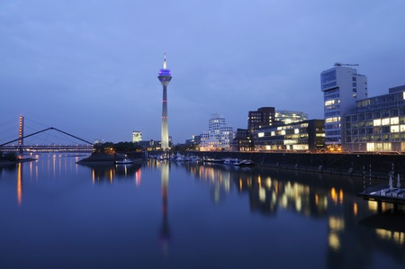 Night scene in Duesseldorf at the Rhine river with the Rheinturm Tower.