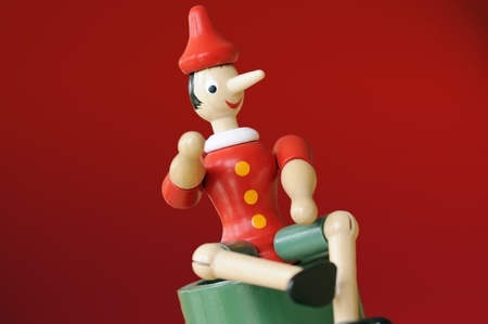 untruth: Pinocchio on red background