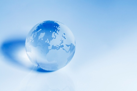 Blue crystal globe focusing on the Europe and Africa area.