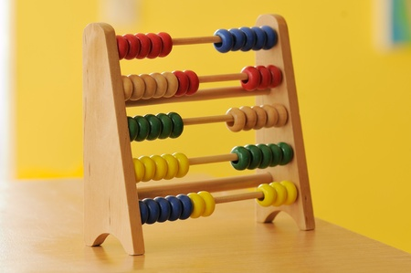 systematic: Colourful wooden abacus, on a yellow background