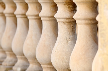 Close up detail with depth of field of balustrade with beige sandstone Columns.