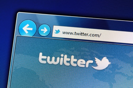 Muenster, Germany - May 23, 2011: The twitter website is displayed in web browser on a computer screen. Twitter is a social networking and microblogging service and enabling its users to send and read messages.