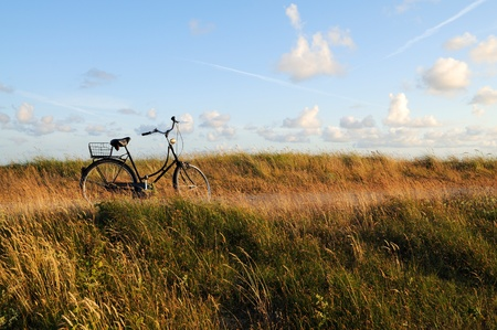bicycle on a coastal boardwalk against a beautiful blue sky, north sea islands of germany.
