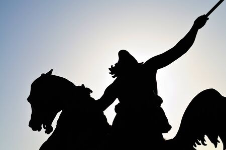 silhouette of a horseman statue  photo