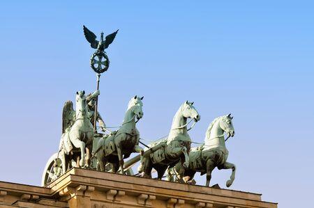 quadriga: Detail of Brandenburg Gate and the Quadriga bronze statue, Berlin, Germany