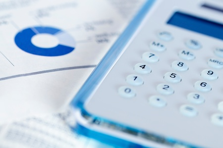 Business concept - Calculator and Charts. Stock Photo - 10894697