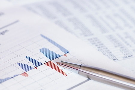 Business concept - Financial planning with stock chart and pen. Archivio Fotografico