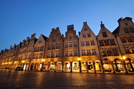 Muenster, Germany - July 28, 2009: Nightshot of the Prinzipalmarkt square at Muenster with its medieval facades and stores in the arcades, Germany. Editoriali