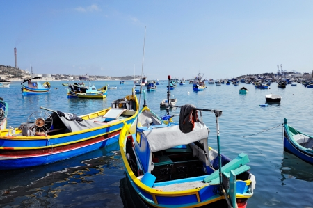 Traditional Maltese fishing boats, called Luzzu, in the harbour of Marsaxlokk, Malta.