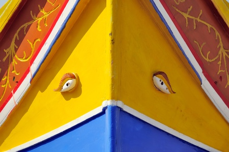 Detail of a Maltese fishing boat, called Luzzu, in the harbour of Marsaxlokk, Malta.