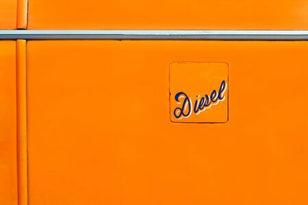diesel fuel: Fuel Hatch, with ornamentally worded Diesel on it. It is a detail of a typical old Maltese bus.