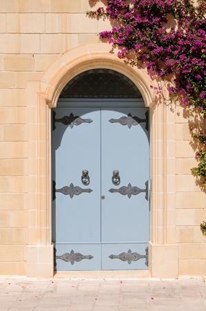 bougainvillea: Large bougainvillea tree growing by doorway in the village of Mdina, Malta.