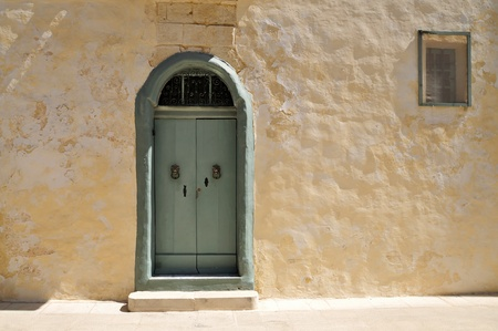 Maltese house with nice mint green door.  Stock Photo