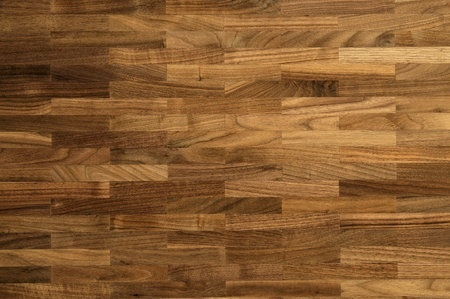 Wood texture - parquet floor made of the natural american walnut wood. Stock Photo