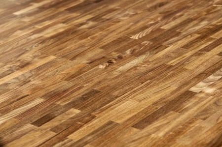 Wood texture - parquet floor made of the natural american walnut wood. photo