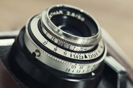 The lens, focus and exposure controls of a simple classic 35mm film camera Stock Photo - 13027468