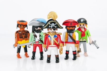 Muenster, Germany - November 8, 2011: A group of Playmobil Pirates on white background. Playmobil are famous construction toys manufactured by the Brandstaetter Group, headquartered in Zirndorf, Germany. Editoriali