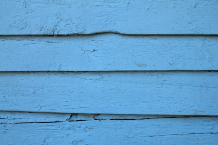 Wood texture - a landscape view of a rustic and worn wooden background, painted blue  photo