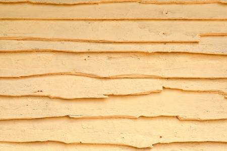 Wood texture - landscape view of a rustic and worn wooden background, painted yellow   photo
