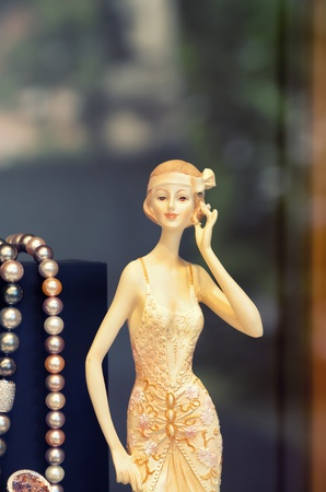 Vintage mannequin in store window, toned image  photo