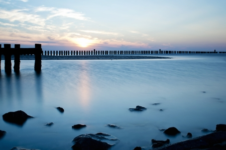 Long exposure of misty sea and rocks, north sea region, Wangerooge, Germany   photo