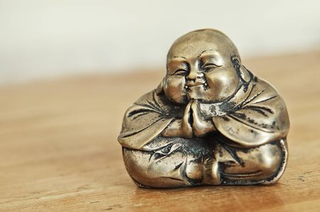 positions: Old antique Budda in Thai style made from bronze, toned image