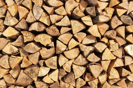 woodpile: Texture - Chopped and stacked pile of pine and birch wood, cut for fireplace. Stock Photo