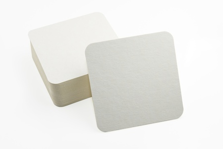 Stack of new beer coasters isolated on a white background  Add your own design