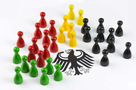 Game figures with federal eagle symbolizing the major political parties in Germany