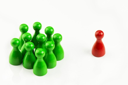 mobbing: Conception - Game figures in a business situation on white background Stock Photo