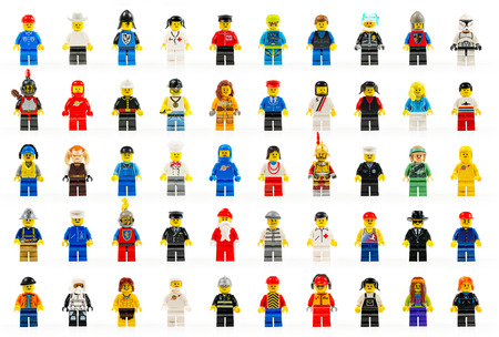A group of fifty various lego mini figures of the past and present on white background  LEGO are famous construction toys manufactured by the Lego Group, a company based in Billund, Denmark Various lego mini figures isolated on white  Editorial
