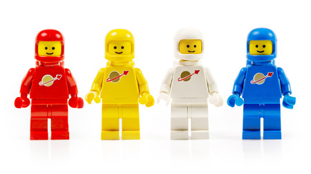 A group of four various astronaut lego mini characters from the 80s isolated on white  Editorial