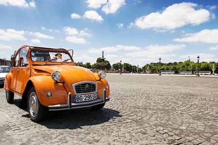 PARIS, FRANCE - JUNE 20, 2014: Old Citroen 2CV parked at Place de la concorde, Paris, France.Antique orange Citroen 2CV is a French produced car, built from 1948 through 1990 with a unconventional look.