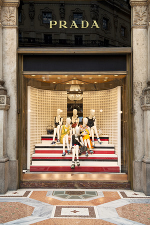 prada: MILAN, ITALY - APRIL 18, 2014: Prada store in one of the worlds oldest shopping mall Galleria Vittorio Emanuele II in Milan. Prada is a luxury leather and fashion company with world renown, founded in 1913 by Mario Prada.