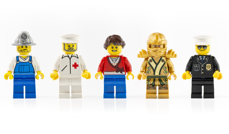 Muenster, Germany - December 7th 2014: A group of five various mini lego characters isolated on white. Lego is a line of construction toys manufactured by the Lego Group popular. Editorial