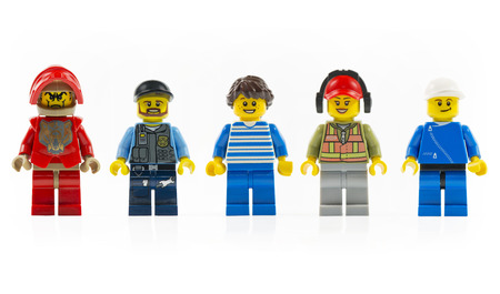 lego: Muenster, Germany - March 8th 2015: A group of five various lego mini characters isolated on white.  Lego is a popular line of construction toys manufactured by the Lego Group.