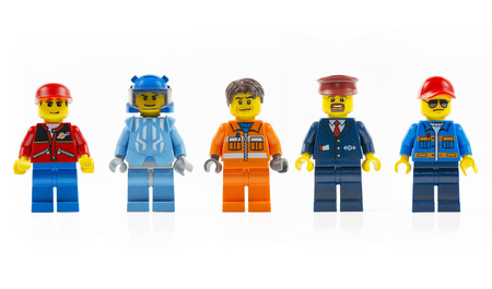 Muenster, Germany - March 8th 2015: A group of five various lego mini characters isolated on white. Lego is a popular line of construction toys manufactured by the Lego Group.