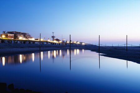 german north sea region: Promenade photographed during a beautiful sunset, north sea region, Wangerooge, Germany.