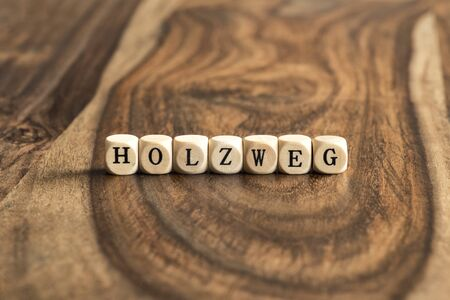 wood blocks: HOLZWEG word background on wood blocks