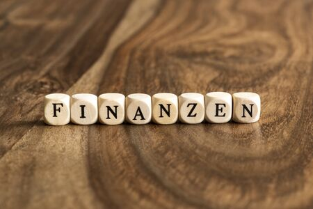 wood blocks: FINANZEN word background on wood blocks Stock Photo